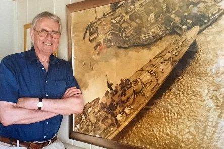 Roy West alongside the iconic photograph he took of HMS Vanguard at Point, Old Portsmouth