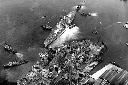 HMS Vanguard aground after just missing the Still and West pub.  Photo: Roy West The News archive