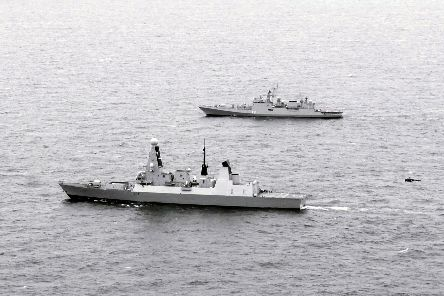 HMS Defender, nearest the camera, with Indian guided-missile frigate Tarkash in the Channel, Aug 14 2019, during Exercise Konkan. An Indian Helix helicopter can be seen approaching Defender's flight deck. Picture: Royal Navy
