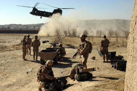 Royal Marines and attached ranks of 40 Commandos Bravo Company Group, based at Sangin, provide medical assistance to wounded Afghan children. Photo:: LA(PHOT) AJ MACLEOD/MoD