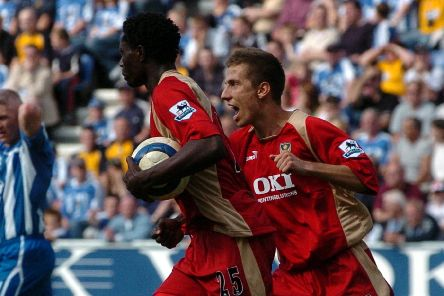 Gary O'Neil, right, celebrates with Benjani after the striker scored against Wigan. Picture: Jonathan Brady