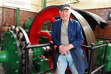 John Watkins, the longest-serving volunteer at Eastney Gas Engine House with one of  'Y2 Type' 180 bhp double-ended Criossley Bros Gas Engines that were installed in 1904 to drive the three massive sewage pumps 'Photographer: Malcolm Wells