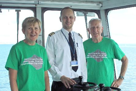 Helen and Dave Hunter with chief officer Sergejs Parahovniks on board St Clare