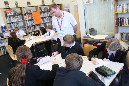 Pupils working on their news articles with education reporter, Neil Fatkin.