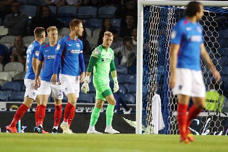 Pompey players after Burton's first goal