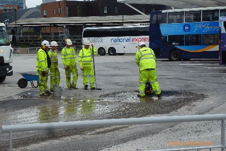 Workers sorting a temporary fix fir the tarmac at the 9.2m Hard Interchange at Portsea Picture: Terry Pearson