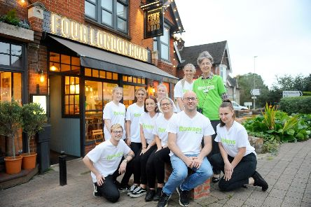 Front middle, Elio Haycock-Martinisi, owner of Four London Road, with his staff and (back right) Rose Wycherley, ambassador for The Rowans Hospice.'Picture: Sarah Standing (101019-8671)