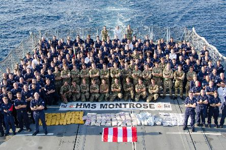The crew of HMS Montrose pose with their drugs haul.