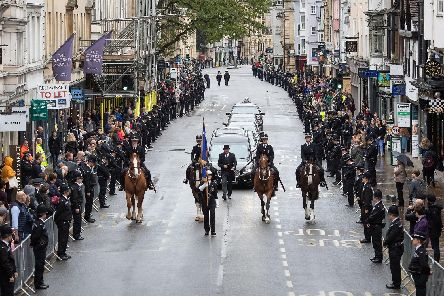 Members of the public line the High Street in Oxford to pay their respects as the funeral cortege for PC Andrew Harper.