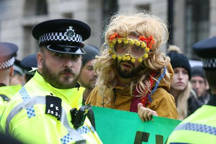 Protesters blocking the road in the City of London during an Extinction Rebellion climate change protest. PA Photo.