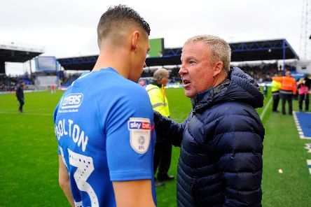 Pompey boss Kenny Jackett talks to James Bolton at the final whistle on Saturday  Picture: Graham Hunt