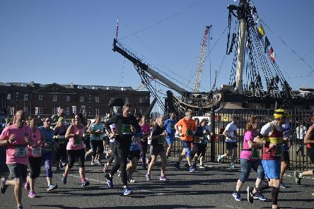 Participants in the Great South Run pass HMS Victory, in Portsmouth Historic Dockyard. Picture: Mary Turner