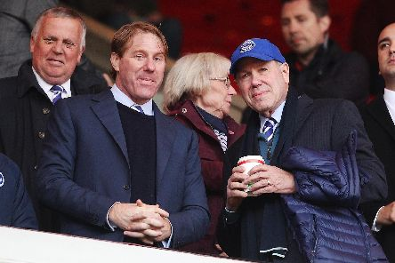 Pompey chairman Michael Eisner, right, with son Eric   Picture: Joe Pepler
