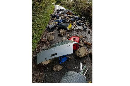 East Hampshire District Council is investigating after fly-tippers dumped this huge pile of hardcore waste between Broadway Lane and Old Mill Lane in Catherington, near Horndean.