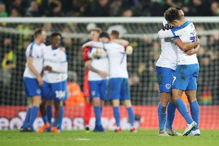 Pompey celebrate their memorable last-gasp victory at Norwich in last season's FA Cup. Picture: Joe Pepler