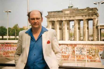 Bob Hind on the western side of the Brandenburgh Gate, behind the Berlin Wall, in 1986.