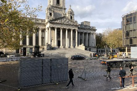 Much of Guildhall Square, Portsmouth, has been closed off today (Tuesday, November 12) as workers begin setting up the city's popular annual ice rink. Picture: Byron Melton