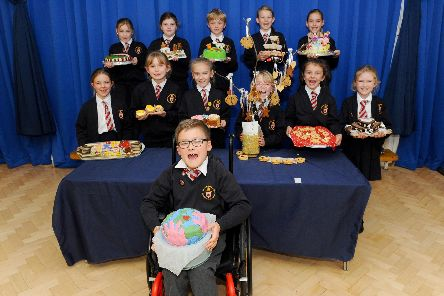 Horndean C of E Junior School in Five Heads Road, Horndean, held a Bake Off competition on Tuesday, November 12 at the school, raising money for Children in Need.''Pictured is: Pupils who came first, second and third in the Bake Off competition.''Picture: Sarah Standing (121119-1852)