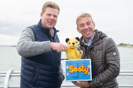 Tommy Ware Jnr sealing the deal with Sooty and Richard Cadell.'Picture: Habibur Rahman
