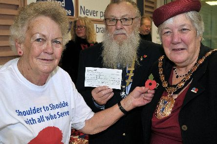 Olive Rush is stepping down as poppy appeal organiser in Havant. Pictured here in 2016 with Mayor Cllr Faith Ponsoby and RBL branch chairman Dave Argue at  the launch of the Royal British Legion Poppy Day at Tesco Extra, Havant.'Pic Mick Young