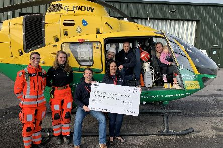 Organisers of Beach Dubbin' hand over a cheque for 10,000 to representatives of the Hampshire and Isle of Wight Air Ambulance. The money was collected at the VW meet in August 2019, held on Southsea Common. Picture: Beach Dubbin'