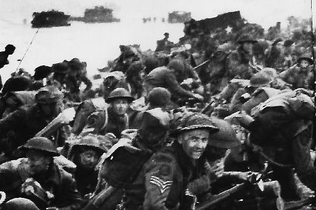 Sergeant Albert Speller,  facing the camera, on a D-Day beach. Picture: Teresa Whichello.
