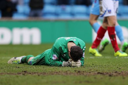 Pompey's Trevor Carson is dejected after Scunthorpe's fifth goal in February 2014 - the Blues' previous heaviest league defeat before Accrington. Picture: Joe Pepler