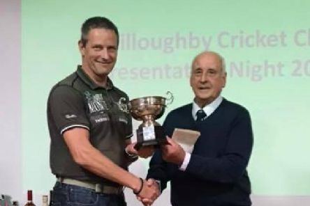 Senior Player of the Year Ashley Rayner receives his trophy from club president Eric Palmer