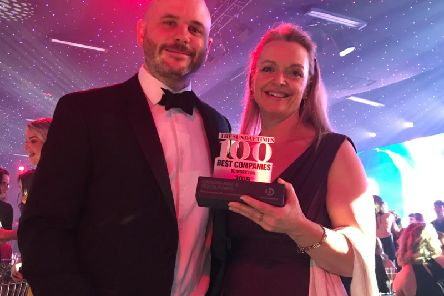 Oakman Inns' Ops Director Alex Ford & HR Director Jill Scatchard celebrate at Sunday Times Best Companies to Work For 2019