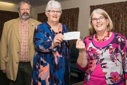 Heather (centre) receiving one of the last donations to the Friends Diamond'Jubilee Appeal.