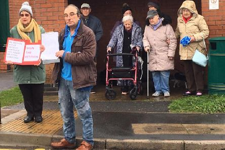 Campaigners in Long Lawford who are calling for changes to their bus service. Pete McLaren is pictured at the front.