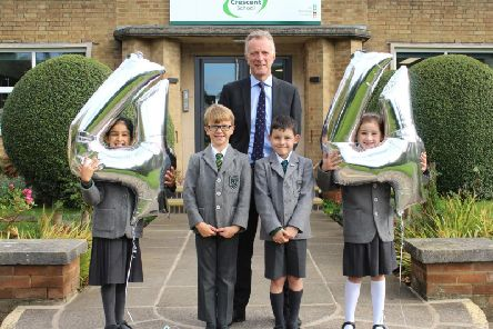 Photo: Left to Right: Mya Toor, Alex Mulhall, Headmaster Joe Thackway, Sam McCormick and Ellie Gane.