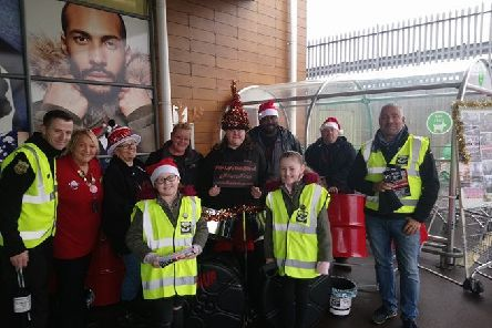 Surviving the Streets UK collecting donations before Christmas with James Robinson on the left