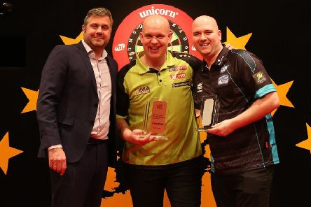 European Open runner-up Rob Cross (right) alongside winner Michael van Gerwen (centre) after the final in Leverkusen. Picture courtesy Sven Neusch�fer/PDC Europe