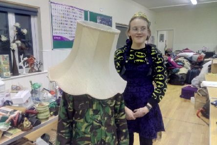 Bexhill 9th Cub Scout Daisy Anzermov and Explorer Scout Lily-Anne Plim find novel ways to display items donated to the Jumble Sale. SUS-190326-105314001