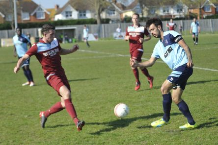 Liam Ward in the thick of the action during Little Common's 1-0 win at home to AFC Uckfield Town on Saturday. Picture by Simon Newstead