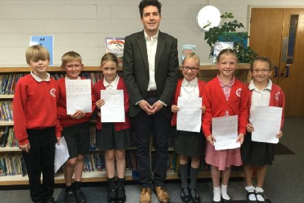 Huw Merriman MP with pupils from Battle and Langton Primary School