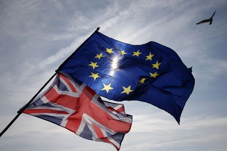 A gull flies above European and Union flags in Brighton on September 24, 2017, during a march against Brexit.'Britain's revitalised Labour opposition kicks off its annual conference today with leader Jeremy Corbyn set to lay out his party's agenda, free from the leadership challenges of previous years. / AFP PHOTO / Daniel LEAL-OLIVAS        (Photo credit should read DANIEL LEAL-OLIVAS/AFP/Getty Images) PNL-190730-120727003