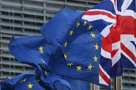 """A Union Jack (R) flies next to European Union flags in front of the European Commission building as British Prime Minister May is due to meet European Commission President Juncker for a dinner in a bid to unblock Brexit talks ahead of a decisive EU summit this week, in Brussels on October 16, 2017.'EU leaders meeting in Brussels on October 19 and 20 are due to decide whether or not negotiators can move on to discussing post-Brexit trade ties with Britain if """"sufficient progress"""" has been made in divorce talks. The indication from the EU side is that they will postpone their decision to a summit in December as the break-up negotiations are currently deadlocked, particularly over the multi-billion-euro exit bill the EU says Britain must pay.' / AFP PHOTO / EMMANUEL DUNAND        (Photo credit should read EMMANUEL DUNAND/AFP/Getty Images) NNL-190823-153601001"""