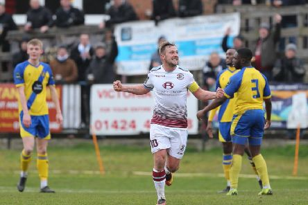 Sam Adams celebrates completing his first ever Hastings United hat-trick in a man-of-the-match performance
