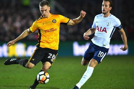 Mickey Demetriou is pressurised by England international Harry Kane during Newport's FA Cup clash against Tottenham Hotspur last season. Picture: Getty Images