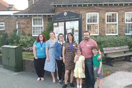 Council chairman Lydia Pope with councillor Lee Cowen and his children outside the parish hall