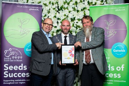 Rustington Parish Council's Chairman Cllr Jon Street and Chairman of the Rustington in Bloom Committee, Steve Perry, receiving the Gold Award for Town Centre of the Year from BBC Surrey/Sussex Gardening expert and DigIt programme host Joe Talbot. Picture: Ciaran McCrickard Photography