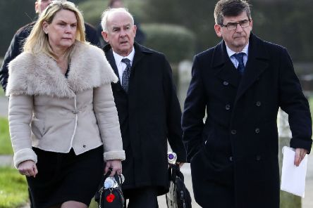 Brenda Elmer's husband Alec Elmer (centre) and her son Jonathan Elmer (right) arrive at West Sussex Coroners Court in Crawley for the inquest. Photo: Steve Parsons/PA Wire