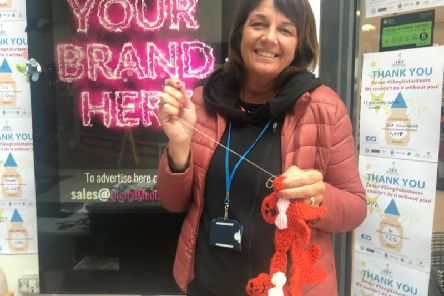 Angela Dobson, manager at Lincolnshire Community and Voluntary'Service (LCVS), sews volunteer bunting to celebrate Skegness Volunteers Week.