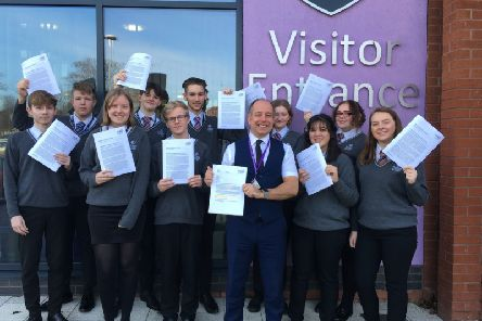 Principal Gary Carlile (right) with students celebrating a positive Ofsted report after a challenging period for Skegness Academy. ANL-190204-071309001
