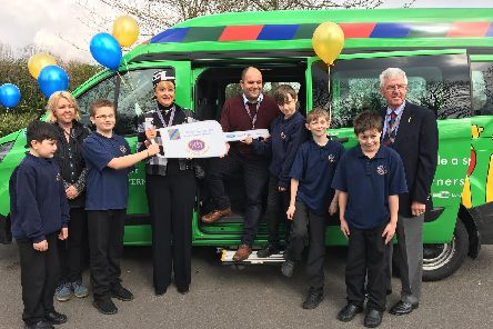 Chris Armond, Executive Head at Woodlands Academy, receives the 'key' to a Lords Taverner's mini bus from Yvonne Wood, Lady Taverner. Also pictured with some of the pipils are Bill Wood, Lords Taverner and Parent Governor, Mandy Walden.