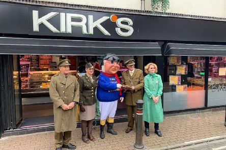 Kirk's Butchers in Skegness handing over the wartime  recipe sausages they have made for the  1940's event at The Village Church Farm in Skegness this weekend. The Jolly Fisherman also popped along to give them the thumbs up. ANL-190513-073914001