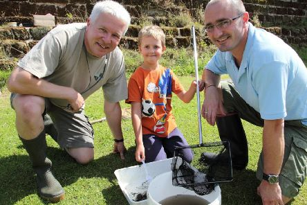 Ecologist Richard Chadd with Will Franklin, eight, and Gavin Franklin.