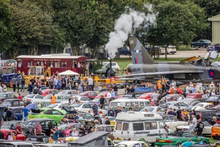 Crowds at Skegness Water Leisure Park around some of the 500 vehicles at the Classic Wheels event, as the Lincolnshire Coast Light Railway's 1903-vintage steam locomotive Jurassic steams towards the XS456, an English Electric Lightning T5.  Photo: Dave Enefer/LCLR
